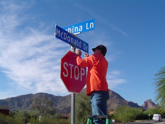 Man reparing street signs.